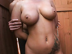 Busty Jayden Fire sucks cock outdoors