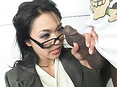 Nice asian hottie sucks on a large black dong