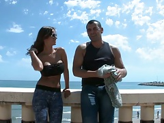 Outdoors with fully clothed Black Angelika showing her ass by the sea
