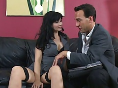 Brunette Carrie Ann in the office getting undressed sucking dick
