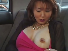 Backseat milf asian showing her tits and pussy