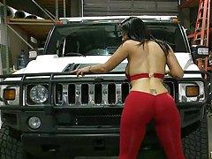 Raquel showing her round curvy ass near a car